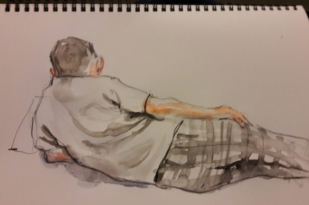 Julian watching tv – waterbrush in sketchbook