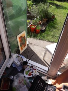Painting an outdoor sketch in warm weather